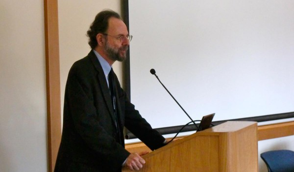 Man in suit speaking at conference
