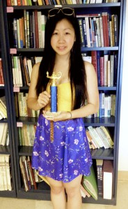 Rilla Peng displays her trophy for winning